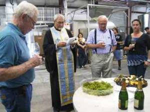 Father John Finley blesses the Lucas & Lewellen harvest